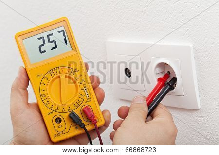 Electrician Hands With Multimeter