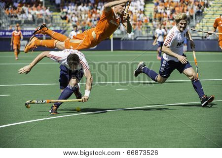 THE HAGUE, NETHERLANDS - JUNE 13: Dutch player Jolie is flying over English field player Lewers, after Lewers tryed take over the ball during the semi-finals of the world cup hockey 2014.