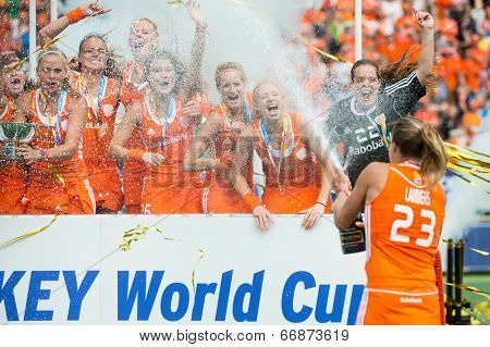 THE HAGUE, NETHERLANDS - JUNE 14: Captain Maartje Lammers of the Dutch field hockey team sprays champagne over her team mates after winning the world championships, beating Australia 2-0