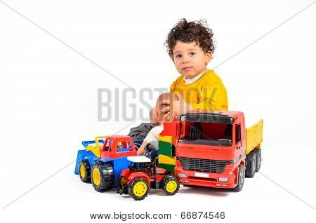 Child With Overabundance Of Toys