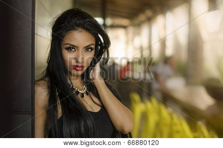 Beautiful young woman looking