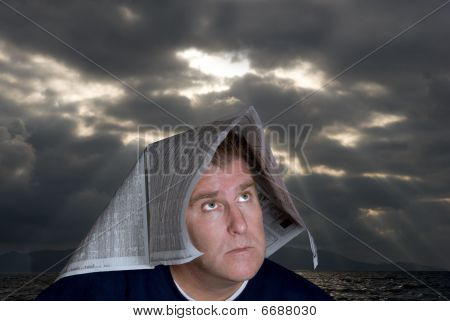 Man With Newspaper Over Head