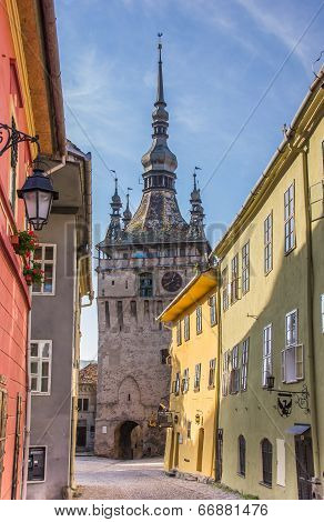 Clock Tower And Colorful Houses Of The Citadel In Sighisoara