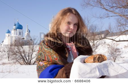Smiling Girl In Russian Traditional  Clothes  With Loaf
