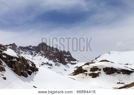 Snow Mountains In Fog