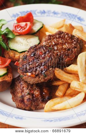 Spicy mini burgers with french fries, fast food