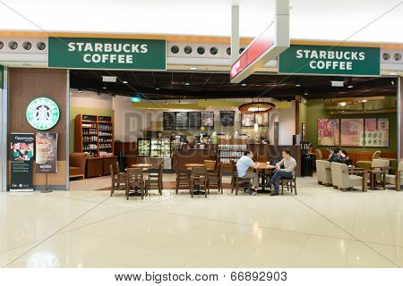 HONG KONG - APRIL 01: Starbucks cafe  in airport on April 01, 2014 in Hong Kong, China. Starbucks Corporation is an American global coffee company and coffeehouse chain based in Seattle, Washington