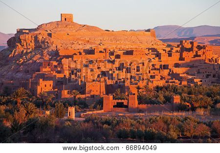 The first rays of the rising sun over Ksar of Ait-Ben-Haddou, Morocco.