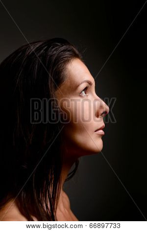 Beautiful Young Woman Staring Up Into The Light