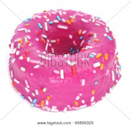 a donut coated with a pink frosting and sprinkles of different colors on a white background