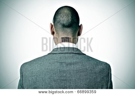 rear view of a businessman with a barcode in his nape
