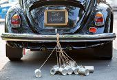 stock photo of married  - Just married sign and cans attached vintag car - JPG