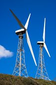 picture of tarifa  - Wind turbines on the green hill with blue sky - JPG