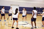 image of netball  - High School Volleyball Match In Gymnasium - JPG