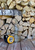 stock photo of kerosene lamp  - Electric torch and kerosene lamp are on a background of firewood - JPG