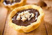 pic of tarts  - Sweet chocolate mini tart on the wooden table - JPG