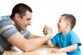 pic of physical education  - kid boy and his dad competing in physical strength - JPG