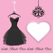 stock photo of little black dress  - Cllassic little black dress hanging on hanger  - JPG