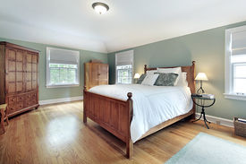 pic of master bedroom  - Master bedroom in suburban home with oak wood furniture - JPG