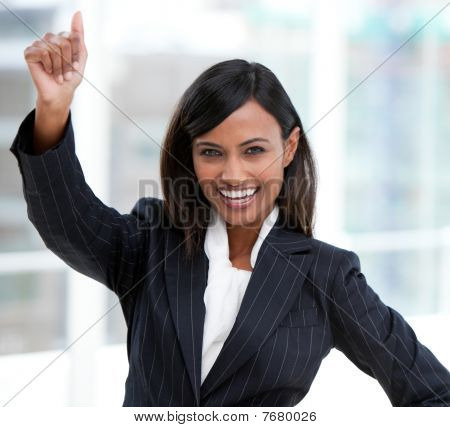 Successful Businesswoman With A Thumb Up Standing