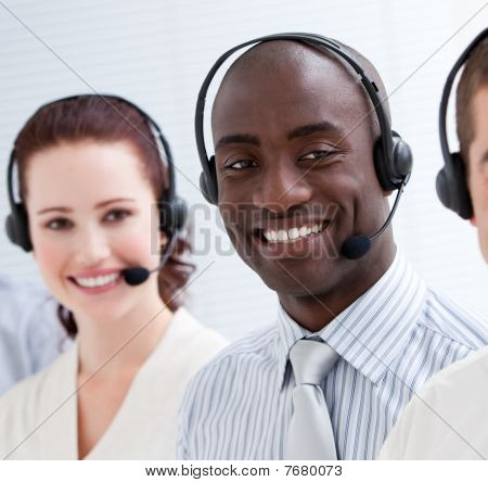 Happy Customer Service Representatives Standing In A Line