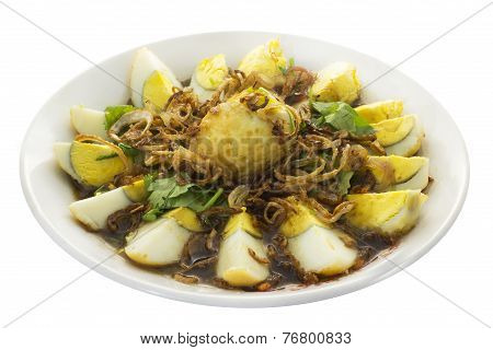 Fried Hard Boiled Eggs In Sweet Tamarin Sauce On White Background