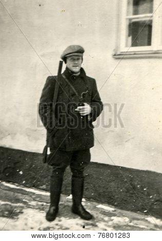 GERMANY, CIRCA 1930: Vintage photo of man with a gun