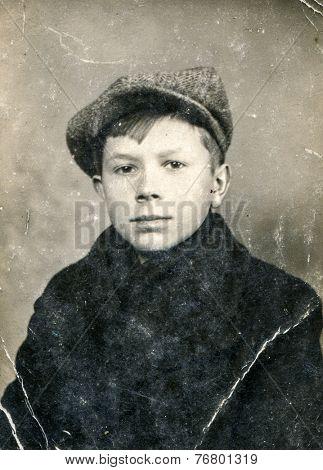 GERMANY, CIRCA 1930:  Vintage photo of boy in cap