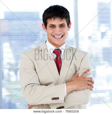 Smiling Businessman With Folded Arms Standing