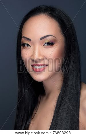 Beauty Portrait Of Asian Model With Cheerful Smile