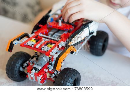 Boy Plays Collects From The Constructor Of  Car