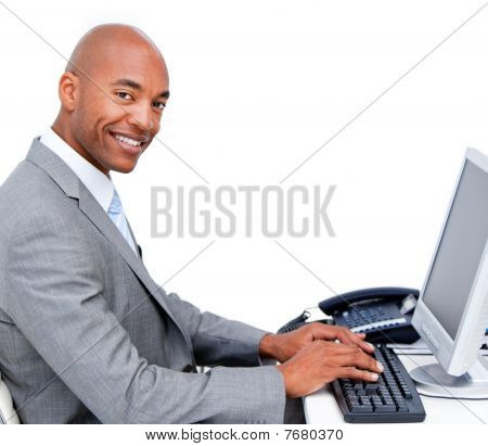 Handsome Businessman Working At A Computer