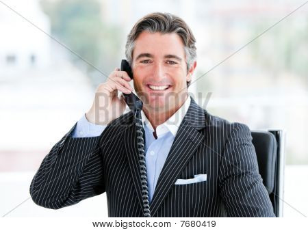 Self-assured Mature Businessman Talking On Phone
