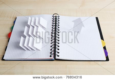 Applique paper with building in notebook