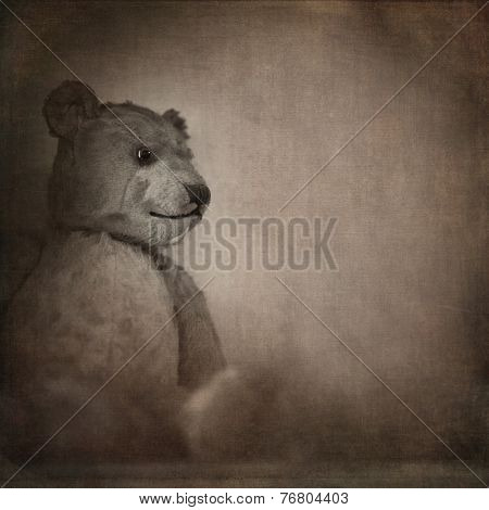 Nostalgic image of an old, well loved bear. Sepia effect with texture and space for text