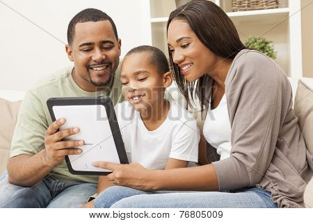 African American family, parents and son, having fun using tablet computer together
