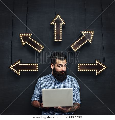 Bearded Man With Laptop Makes Decision