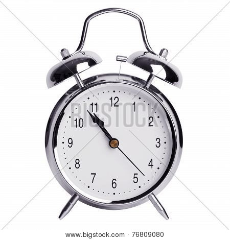 Five Minutes To Eleven On A Alarm Clock