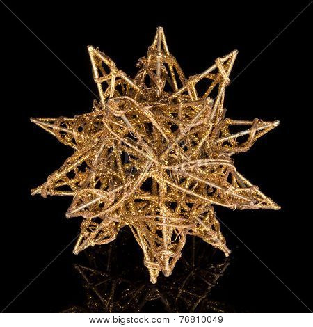 Gilded Star Isolated On Black Background