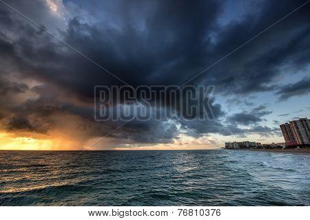 Rain At Sunrise Over Ocean.