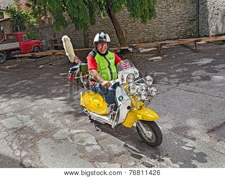 Biker Riding A Vintage Scooter Lambretta