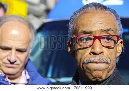 Rev Al Sharpton leaving rally