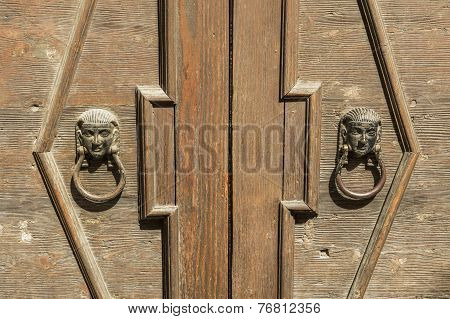 Old Wooden Door With Knocker In Bronze