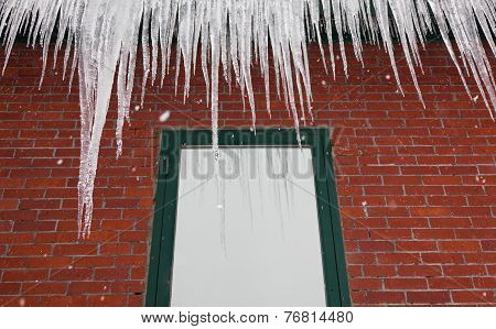 Icicles On A Red Brick Building