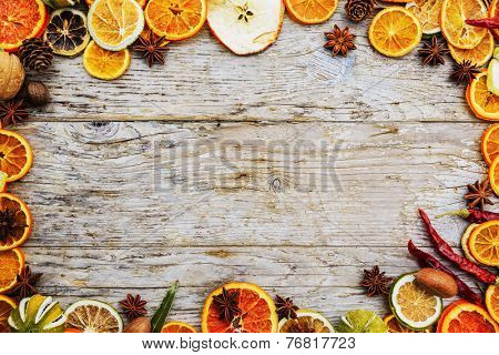Dried fruit and spices on wooden background, space for text