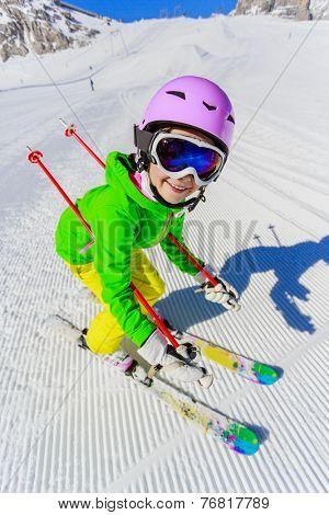 Skiing, winter, ski lesson - young skier on ski run