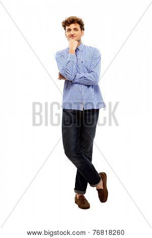 Full length portrait of a handsome man standing over white background