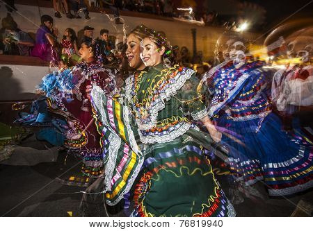 Multiple Exposure Of Folklorico Dancers In Dia De Los Muertos Makeup