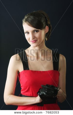 Brunette In Red Dress And Gloves