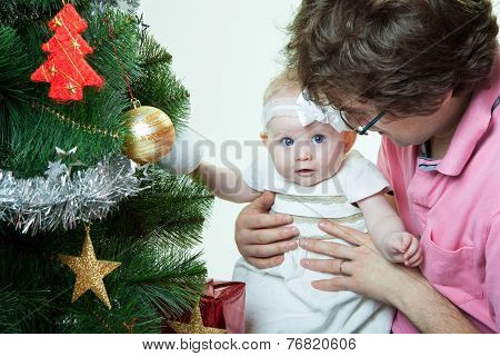 Christmas baby girl with father